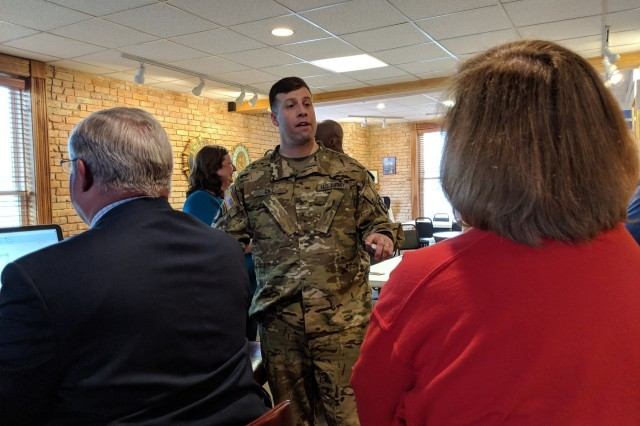 Col. Clair A. Gill, 10th Combat Aviation Brigade commander, meets with community members March 28 in Gouverneur and Lowville, New York, to discuss Falcon's Peak, a readiness-building exercise scheduled April 9-18.