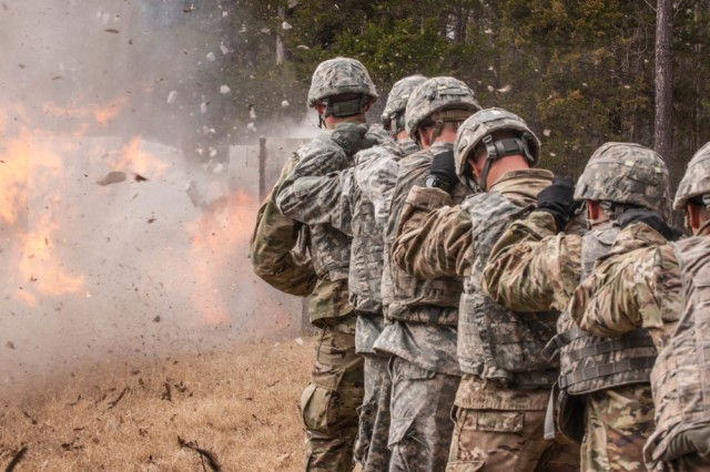 Deputy PAO Stephen Standifird won first place for his photo featuring Fort Leonard Wood's Sapper Leader Course 06-17 as the squad detonates a silhouette charge to create an entrance through a wall during urban breaching exercises as part of the course.