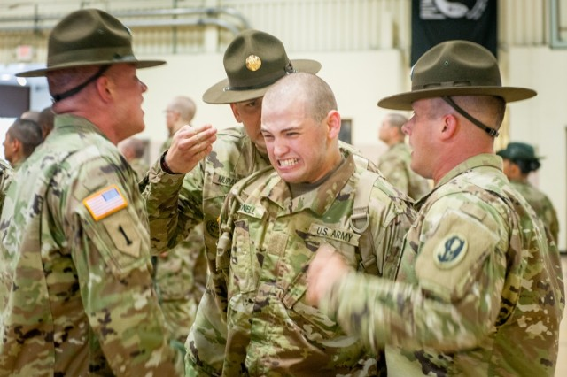 "Standifird won first place for his picture story, ""Welcome to Fort Leonard Wood,"" featuring drill sergeants in the newly activated 2nd Battalion, 48th Infantry Regiment, as they welcome Soldiers to Fort Leonard Wood as part of the End Strength Increase in 2017."