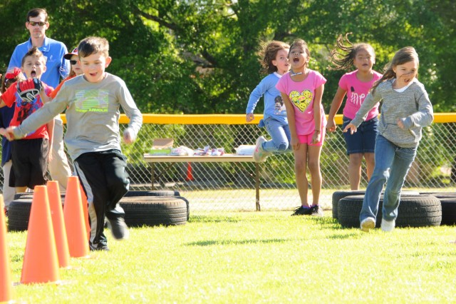Children take turns racing through an obstacle course at last year's youth health and nutrition fair. This year's event is scheduled for April 5 from 4-7 p.m. at the youth football fields.