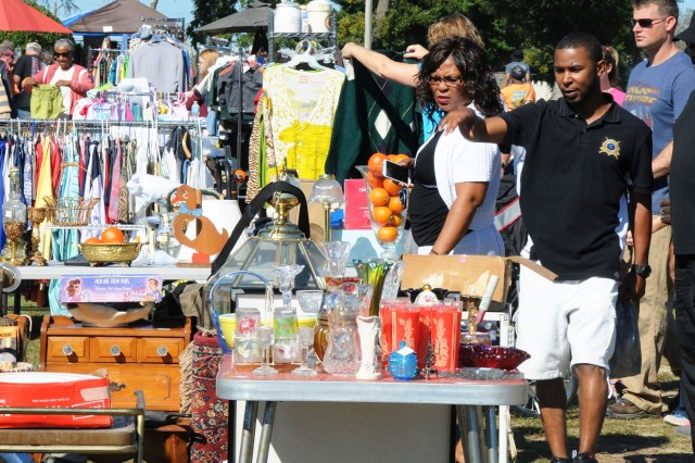 Shoppers point out finds at a previous outdoor yard sale. This year's Fort Rucker Outdoor Yard Sale and Flea Market is scheduled for April 7.