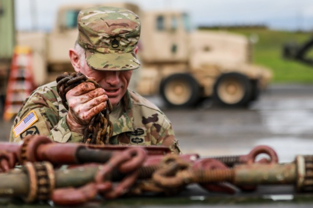 A U.S. Army Reserve Soldier prepares for convoy operations during Operation Patriot Bandolier at Military Ocean Terminal Concord, California, Mar. 2, 2018. Operation Patriot Bandolier is a real-world strategic mission utilizing U.S. Army Reserve, National Guard and Active component Soldiers transport Army materiel and munitions containers across the U.S.(U.S. Army photo by Sgt. Eben Boothby)
