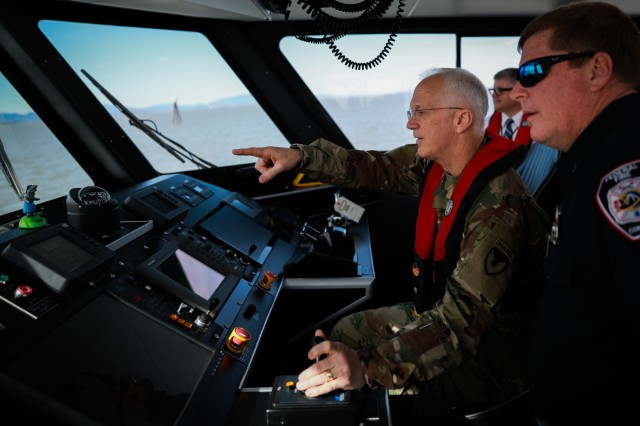 Maj. Gen. Allen M. Harrell drives one of two U.S. Army fire boats during Operation Trans Mariner 18 West at Military Ocean Terminal Concord, California, Mar. 6, 2018. Trans Mariner 18 West is a real-world strategic mission utilizing U.S. Army Reserve, National Guard and Active component Soldiers to conduct Port Operations allowing Army materiel and munitions containers for travel onward.(U.S. Army photo by Sgt. Eben Boothby)