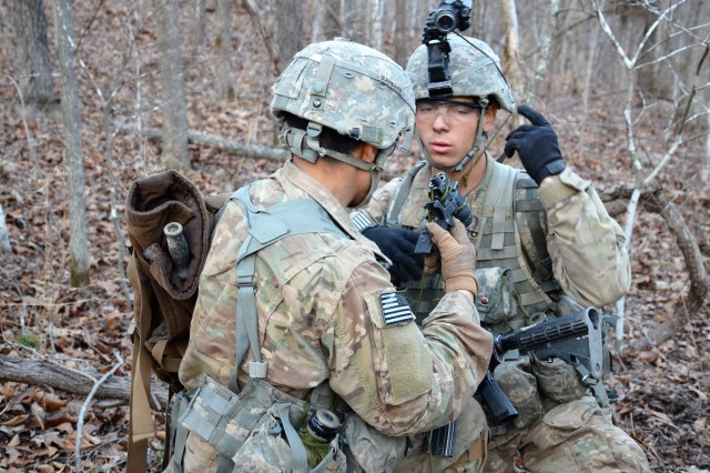 Candidates of the Sapper Leader Course 006-18, conduct a man-weapons equipment check to ensure they are fully ready to fight during a patrolling exercise March 5, at Fort Leonard Wood, Missouri.