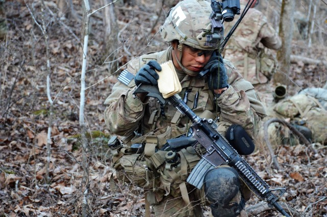 Sgt. Peter Cortez, a bridge crewmember with the 54th Brigade Engineer Battalion, Vincenza, Italy, uses a radio to communicate during a field training exercise with the Sapper Leader Course March 5, at Fort Leonard Wood, Missouri.