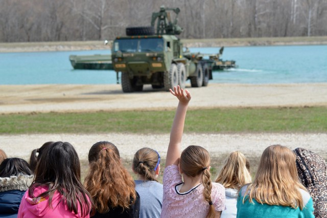 Freedom Elementary School fourth-graders watch an Army engineering demonstration March 22 at TA 250.