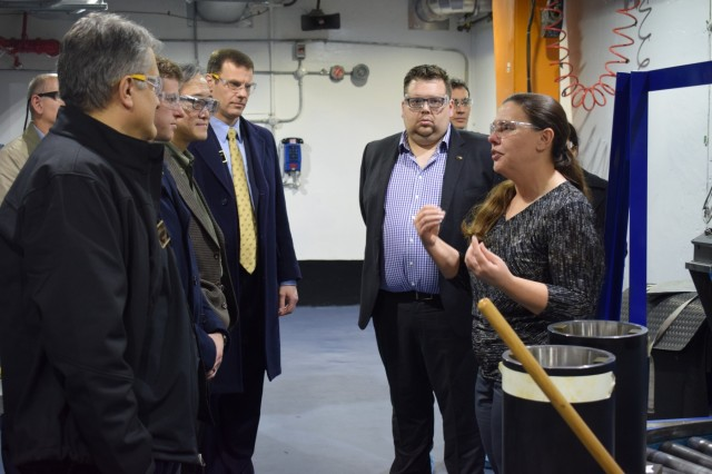 Lara Zilafro, (right) explains the pyrotechnic fabrication process to visitors during a tour of the Crane Army Ammunition Activity pyrotechnics facility. Women's contributions to CAAA help the Activity provide munitions readiness to the U.S. Army and the Joint Force.