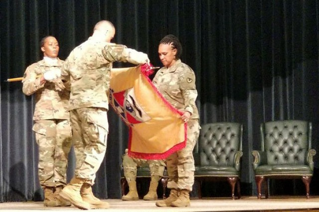 Col. Brad Hodge, left, and Command Sgt. Maj. Cynthia Perryman case the 419th Contracting Support Brigade colors during a ceremony March 28 at Fort Bragg, North Carolina. The brigade deploys in the coming days to Afghanistan where it will replace the 418th CSB as the lead Army element for Army Contracting Command-Afghanistan.