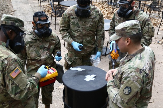 Sergeant Ivan Franco (right), a decontamination team leader for a chemical response team assigned to the 68th Chemical, Biological, Radiological, Nuclear (CBRN) Company (Technical Escort), 2d CBRN Battalion out of Fort Hood, Texas and member of the current ground collection task force, teaches the incoming GCTF team on following proper procedures, collection techniques, maintaining their PPE (personal protective equipment), and ensuring they get sufficient sample evidence. Soldiers from the 20th Chemical, Biological, Radiological, Nuclear, Explosives (CBRNE) Command and various government agencies came together at Aberdeen Proving Ground to train for the National Technical Nuclear Forensics (NTNF) Ground Collection Task Force (GCTF) mission during the first two weeks of March.