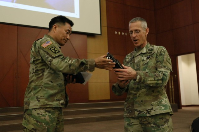 Chaplain (Col.) Chul W. Kim, Eighth Army command chaplain, gifts a water bottle to Ch. (Maj. Gen.) Paul K. Hurley, U.S. Army chief of chaplains, at Freedom Chapel, U.S. Army Garrison Humphreys, South Korea, March 28.