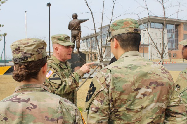 Lt. Gen. Michael A. Bills, Eighth Army commanding general, congratulates soldiers from 2nd Combat Aviation Brigade and 210th Field Artillery Brigade, 2nd Infantry Division, at Eighth Army Headquarters, U.S. Army Garrison Humphreys, South Korea, March 28. The soldiers were commended for their performance in the 43rd Annual Joint Culinary Training Exercise held in Fort Lee, Virginia, where they were awarded with two gold medals, five silver medals and six bronze medals.