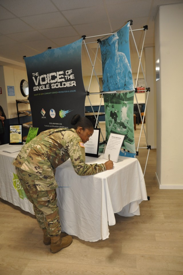 Army Pfc. Maria McClain learns about the program at BOSS Fair