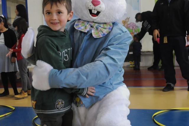 Lorenzo Petrera meets the Easter Bunny during Child, Youth and School Services' Eggstravaganza on Chièvres Air Base, Belgium, March 24, 2018. The event was an opportunity for the U.S. Army Garrison Benelux and SHAPE communities to celebrate the beginning of springtime and Easter.