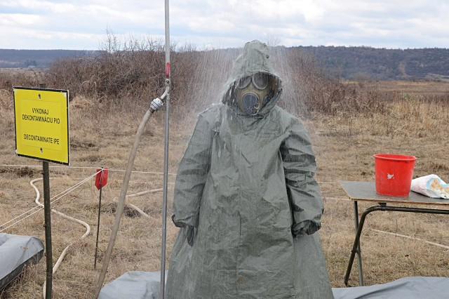 Slovakian Mechanized Infantry soldiers safeguard from possible contaminants at the personnel decontamination site as part of Toxic Lance at Training Center Lest, Slovakia,March 20, 2017. Slovakia is part of the State Partnership Program with Indiana.