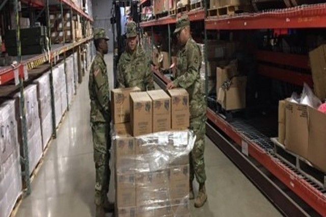 Spc. Jordan Murray, Spc. Anthony Hernandez, and Spc. Christopher Scanlan, start the inspection of the tailored operational training meals by collecting random samples.