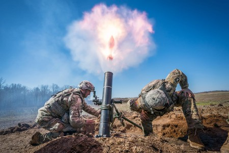 Two Indirect Fire Infantrymen fire a 120mm mortar during Mortar Training and Evaluation Program at Fort Campbell, Ky. During this exercise, mortar crews build proficiency receiving fire missions and placing accurate rounds on target. The Soldiers are with 2nd Battalion, 327th Infantry Regiment, 1st Brigade Combat Team, 101st Airborne Division.