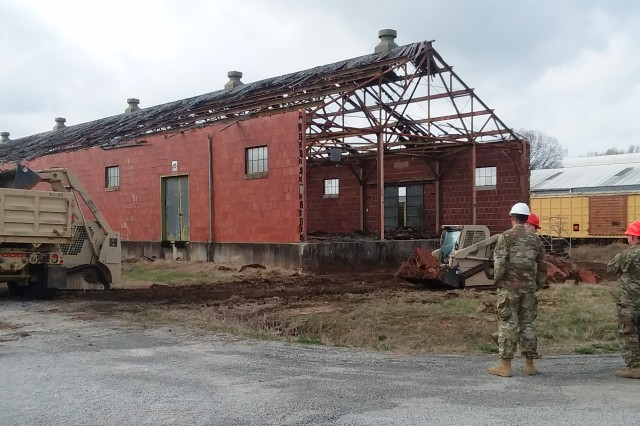 Soldiers of the Tennessee Army National Guard, 230th Engineer Battalion, 913th Engineer Company, perform clay tile clean-up at an inert storage facility demolition on the Milan Army Ammunition Plant.