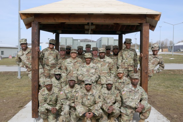 U.S. Army Soldiers assigned to the 859th Engineer Company from the Mississippi Army National Guard pose in the gazebo they built at the Joint Multinational Readiness Center's Hohenfels Training Area. Unfortunately a shortage of material prevented the tile roofing from being installed, but the final product is still a shining example of U.S. Army National Guard Soldiers and their quality craftsmanship, while displaying Army teamwork. These Soldiers spent their annual training at the Joint Multinational Readiness Center's Hohenfels Training Area, Hohenfels, Germany, building several construction projects March 11 -- 31. For many of the younger Soldiers this is the first time building anything of this scale since their initial military occupational skill training.