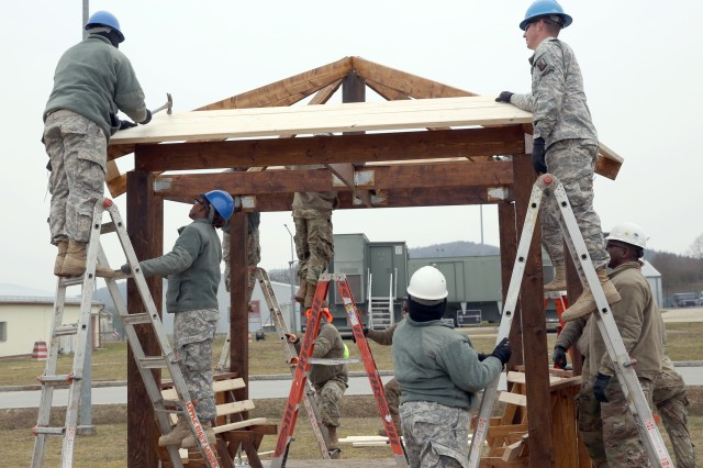 U.S. Army Soldiers assigned to the 859th Engineer Company from the Mississippi Army National Guard continue building the roof section of the gazebo. These Soldiers spent their annual training at the Joint Multinational Readiness Center's Hohenfels Training Area, Hohenfels, Germany, building several construction projects March 11 -- 31. For many of the younger Soldiers this is the first time building anything of this scale since their initial military occupational skill training.