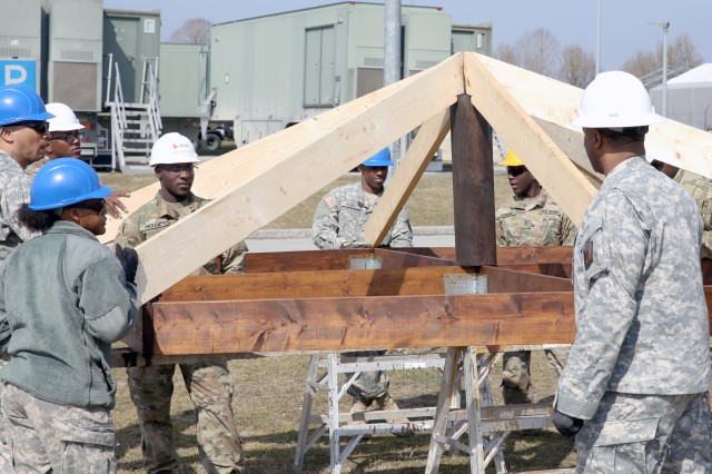 U.S. Army Soldiers assigned to the 859th Engineer Company from the Mississippi Army National Guard start to preassemble part of the roof section that will soon be placed on top of the gazebo to ensure everything fits correctly. These Soldiers spent their annual training at the Joint Multinational Readiness Center's Hohenfels Training Area, Hohenfels, Germany, building several construction projects March 11 -- 31. For many of the younger Soldiers this is the first time building anything of this scale since their initial military occupational skill training.