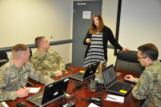 Peyton Rowley talks to Soldiers working on the requirements for a contract March 22, 2018, at Fort Lee, Virginia. Rowley is a contracting officer in the Mission and Installation Contracting Command-Fort Lee office.