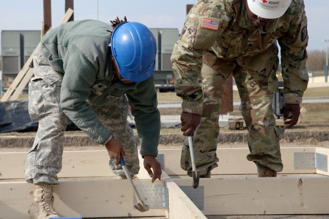 U.S. Army Soldiers assigned to the 859th Engineer Company from the Mississippi Army National Guard assemble a roof section for the gazebo. These Soldiers spent their annual training at the Joint Multinational Readiness Center's Hohenfels Training Area, Hohenfels, Germany, building several construction projects March 11 -- 31. For many of the younger Soldiers this is the first time building anything of this scale since their initial military occupational skill training.
