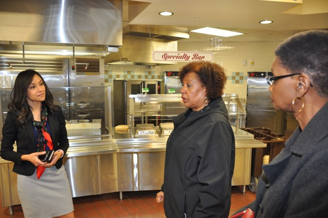 Debbie Frankovich talks to Brenda Battle and Marilyn Johnson March 22, 2018, at a dining facility on Fort Lee, Virginia. Frankovich is the director of the Mission and Installation Contracting Command-Fort Lee office, Battle is a contracting officer representative from the Logistics Readiness Center, and Johnson is a contracting officer with MICC-Fort Lee.