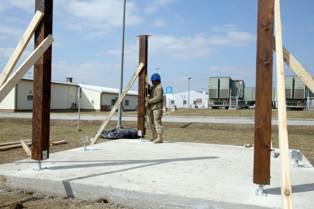 A U.S. Army Soldier assigned to the 859th Engineer Company from the Mississippi Army National Guard verifies the level status of a vertical support beam, which will soon begin to resemble a gazebo. These Soldiers spent their annual training at the Joint Multinational Readiness Center's Hohenfels Training Area, Hohenfels, Germany, building several construction projects March 11 -- 31. For many of the younger Soldiers this is the first time building anything of this scale since their initial military occupational skill training.