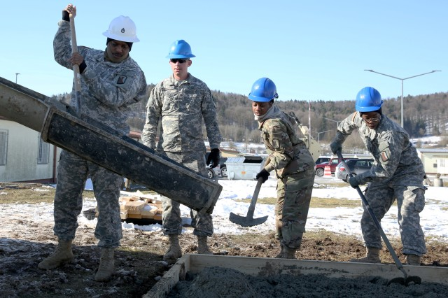 U.S. Army Soldiers assigned to the 859th Engineer Company from the Mississippi Army National Guard pour concrete, which will become the concrete foundation under the gazebo. These Soldiers spent their annual training at the Joint Multinational Readiness Center's Hohenfels Training Area, Hohenfels, Germany, building several construction projects March 11 -- 31. For many of the younger Soldiers this is the first time working with concrete since their initial military occupational skill training.
