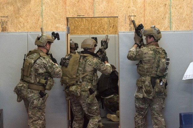 Soldiers from 3rd Special Forces Group (Airborne) practice entering and clearing a room of enemy combatants at the 3rd SFG (A) combatives dojo.