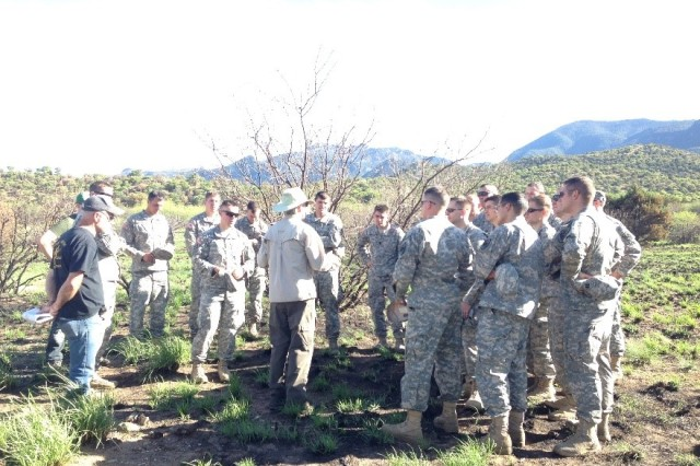Fort Huachuca cultural resources personnel and the course instructor discussing cultural resources with Soldiers from the MI Captain's Career Course Advanced Seminar at a recently-burned archaeological site in FY16.  Cultural resources personnel support this biannual military outreach event to teach future Army leaders about the importance of archaeological resource management.  The goal is for these Captains to understand that they will encounter cultural resources at home and in-theater, and pass on the lesson to the Soldiers they will lead.