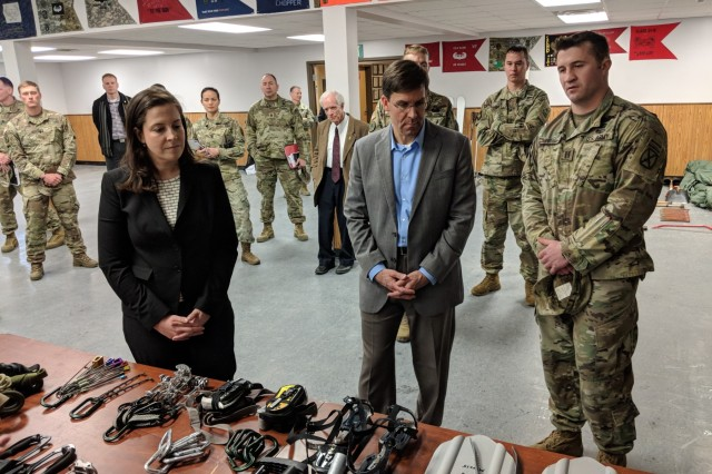 During his visit to Fort Drum, New York on Mar. 29, 2018, Secretary of the Army Mark T. Esper observes a rappelling demonstration at the Light Fighters School and is briefed by the school's cadre March 29 on the new winter warfare gear issued to Soldiers and winter survival training that was introduced last year when Fort Drum was re-designated as an Arctic Zone base.