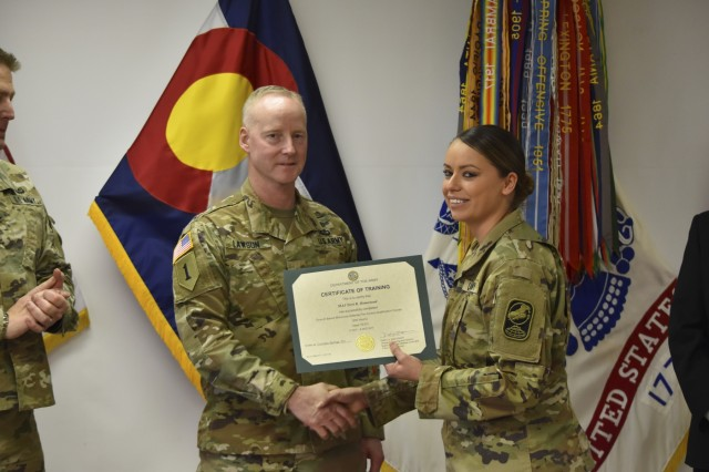 Army Maj. Terri Rae Lopez-Homestead stands with Brig. Gen. Timothy Lawson, deputy commanding general for operations, U.S. Space and Missile Defense Command/Army Forces Strategic Command, during a Dec. 5, 2017, graduation ceremony at 100th Missile Defense Brigade (GMD) Headquarters in Colorado Springs, Colo., to recognize nine Soldiers' successful completion of the Ground-based Midcourse Defense Fire Control Operator Qualification Course (GQC). Homestead is now serving as the first female tactical crew director of a missile defense crew at Fort Greely, Alaska. (U.S. Army National Guard photo by Capt. Jennifer Beyrle/Released)