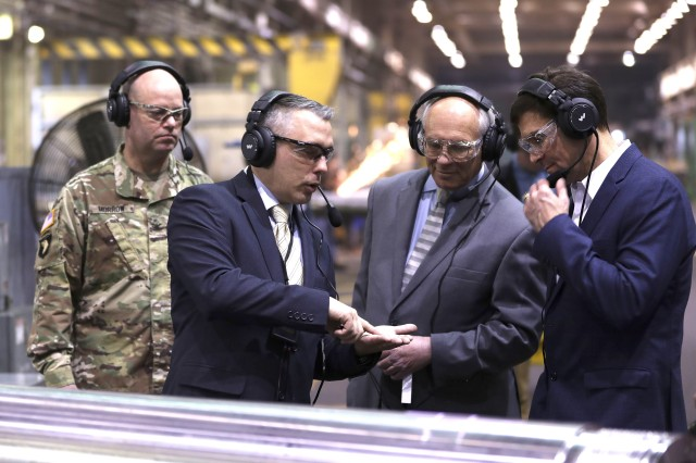 Chief of Manufacturing John Zayhowski, second from left, briefs Congressman Paul Tonko and Secretary of the Army Mark Esper, right, at Watervliet Arsenal, March 30, 2018. Arsenal commander Col. Joseph Morrow is to the left.