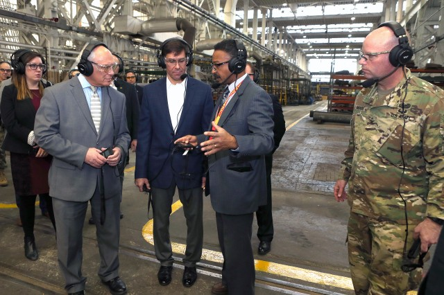 ARDEC-Benet Laboratories' Deputy Director John Askew, second from right, briefs Secretary of the Army Mark Esper and Congressman Paul Tonko at Watervliet Arsenal, March 30, 2018.