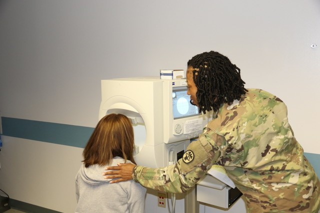 Staff Sgt. Stefanie Marshall, Eye Technician, performs a visual field assessment on a patient in the Optometry Clinic at the USAHC-SB. Optometrists and support staff will welcome visitors to their open house on March 22 at the Optometry Clinic.