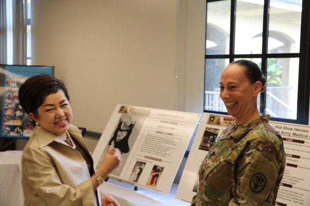 Mrs. Benjawan Sitthisat, spouse of the Royal Thai Army Chief of Staff, shares a laugh with Lt. Col. Evelyn Vento while discussing ballroom dancing on Feb. 13, 2018. Vento described how art therapy has been integrated into Army Medicine's plan to support the use of board certified art therapists.