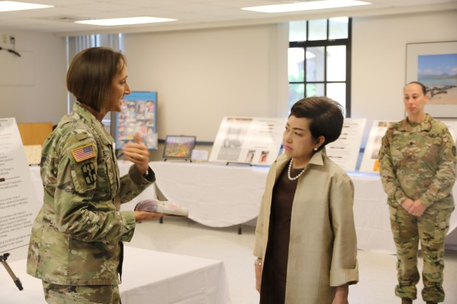 Col. Deydre Teyhen provides an example of Soldier art to visitors from the Royal Thai Army, USARPAC and the 25th Infantry Division on Feb. 13, 2018. Teyhen described the two faces that are often created when Soldiers design masks during therapy.