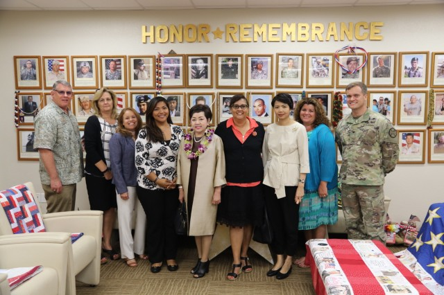 Leaders from across the U.S. Army Garrison-Hawaii and the 25th Infantry Division pose for a photo at the Soldier and Family Assistance Center on Feb. 13, 2018. Mrs. Benjawan Sitthisat (front and center) was able to see firsthand where Gold Star Families meet and  receive support.