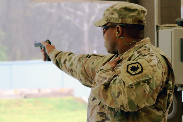 U.S. Army Reserve Staff Sgt. Augustine Ohaeri, a drill sergeant with the 98th Training Division (Initial Entry Training) that is headquartered out of Fort Benning, Georgia, fires his service pistol in the bullseye pistol match during the 2018 U.S. Army Small Arms Championships at Fort Benning, Georgia March 11-18, 2018. Each year, the U.S. Army Marksmanship Unit hosts the All Army competition to develop marksmanship skills, recognize superior marksmanship skill levels and advance Army lethality. The competition is open to cadets and Soldiers from the active duty, National Guard and Reserve. This year's competition had 18 cadets, 108 active duty, 60 National Guard and 48 Reserve Soldiers competing for various titles. (U.S. Army Photo by Michelle Lunato/released)