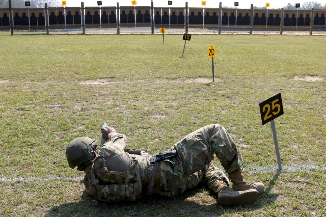 U.S. Army Reserve Staff Sgt. Augustine Ohaeri, a drill sergeant with the 98th Training Division (Initial Entry Training) headquartered at Fort Benning, Georgia, fires his service pistol in the bullseye pistol match during the 2018 U.S. Army Small Arms Championships at Fort Benning March 15, 2018. Each year, the U.S. Army Marksmanship Unit hosts the All Army competition to develop marksmanship skills, recognize superior marksmanship skill levels and advance Army lethality. The competition is open to cadets and Soldiers from the active duty, National Guard and Reserve. This year's competition had 18 cadets, 108 active duty, 60 National Guard and 48 Reserve Soldiers competing for various titles. (U.S. Army photo by Michelle Lunato)