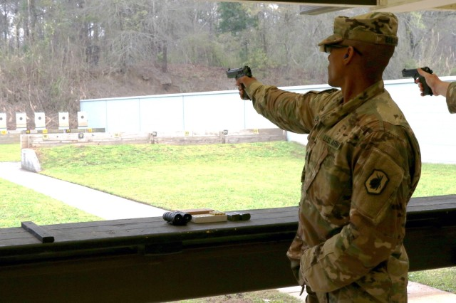 U.S. Army Reserve Sgt. 1st Class Radhames Delgado, a drill sergeant candidate with the 98th Training Division headquartered at Fort Benning, Georgia, competes in the bullseye pistol match during the 2018 U.S. Army Small Arms Championships at Fort Benning, Georgia March 11-18, 2018. Each year, the U.S. Army Marksmanship Unit hosts the All Army competition to develop marksmanship skills, recognize superior marksmanship skill levels and advance Army lethality. The competition is open to cadets and Soldiers from the active duty, National Guard and Reserve. This year's competition had 18 cadets, 108 active duty, 60 National Guard and 48 Reserve Soldiers competing for various titles. (U.S. Army Photo by Maj. Michelle Lunato/released)
