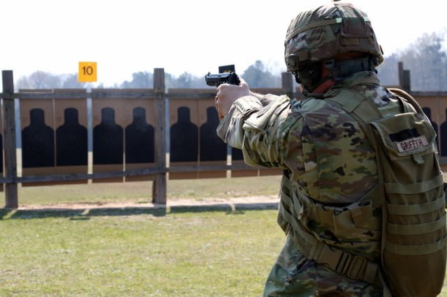 U.S. Army Reserve Sgt. 1st Class Bradford Griffith, who is assigned to the 108th Training Command (Initial Entry Training) out of Charlotte, North Carolina, competes in a pistol match during the 2018 U.S. Army Small Arms Championships at Fort Benning, Georgia March 11-18, 2018. Each year, the U.S. Army Marksmanship Unit hosts the All Army competition to develop marksmanship skills, recognize superior marksmanship skill levels and advance Army lethality. The competition is open to cadets and Soldiers from the active duty, National Guard and Reserve. This year's competition had 18 cadets, 108 active duty, 60 National Guard and 48 Reserve Soldiers competing for various titles. (U.S. Army Photo by Maj. Michelle Lunato/released)