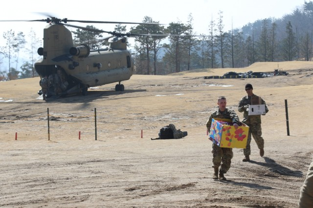 Soldiers offload boxes of Girl Scout cookies to Combined Task Force Defender in Seongju, South Korea, donated by the Osan Girl Scouts of Osan Air Base, South Korea, March 13, 2018.The Osan Girl Scouts collected and donated nearly 200 boxes of cookies to the remote location as part of project of brining cookies to those that may not have access otherwise.