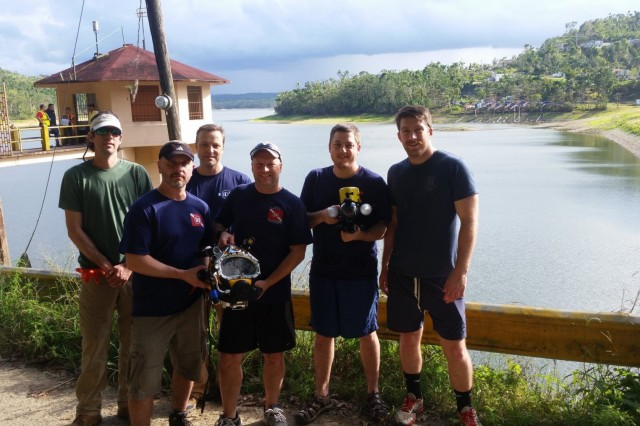The USACE Technical Services Dive Team completed ROV and Dive Inspections at the Guajataca Dam in Puerto Rico from Feb. 26-28, 2017 in support of Jacksonville District, U.S. Army Corps of Engineers repairs for FEMA to collect detailed facility conditions and measurements for upcoming repair work.Team member order in the group shot are (L-R) Andrew Hannes, Mike Draganac, Dave Bala, Shanon Chader, Weston Cross, Brian Dockstader. (Photo by Dave Mastriano, Jacksonville District)