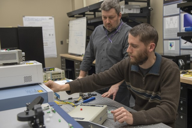 Brian Kirby (right) and Michael Brodsky of the U.S. Army Research Laboratory experiments on how physical properties of fibers affect the distributed entanglement necessary for quantum networking. The ARL project, led by Daniel Jones, who is not pictured, is part of the Defense Laboratory Quantum Science and Engineering Program.