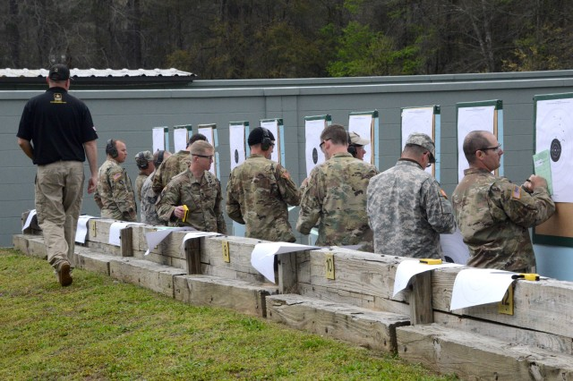 "FORT BENNING, Ga. (April 2, 2018) -- In an excellence in competition pistol match March 17, Soldiers from around the Army score their pistol targets during the 2018 U.S. Army Small Arms ""All Army"" Championship. The ""All Army,"" hosted by the U.S. Army Marksmanship Unit, included numerous individual and team matches such as pistol and rifle excellence in competition matches; combat rifle and pistol courses of fire and a multi-gun course of fire. (U.S. Army photo by Sgt. 1st Class Julius Clayton /released)"