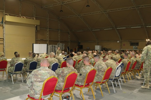Soldiers listen and respond with questions and commentary during the interactive training provided by Capt. Megan Welch, victim advocate for the 28th Infantry Division. More than 90 soldiers attended the division Headquarters and Headquarters Battalion initial SHARP training while deployed to Kuwait, March 19. The unit plans a series of SHARP trainings throughout its deployment.