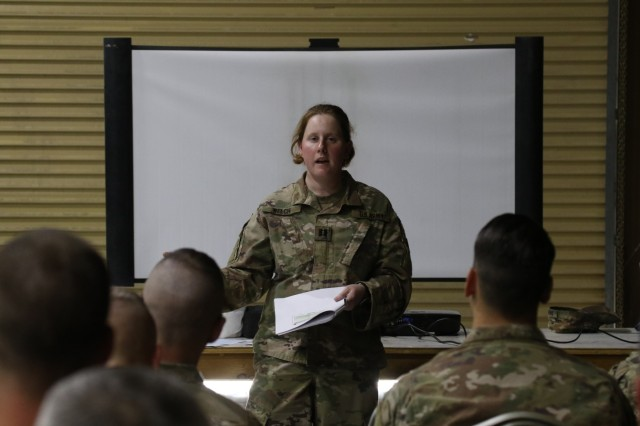 CAMP ARIFJAN, Kuwait - Capt. Megan Welch, victim advocate for the 28th Infantry Division provides interactive training March 19 to more than 100 soldiers during the Headquarters and Headquarters Battalion first SHARP training while deployed to Kuwait. The unit plans a series of SHARP trainings throughout its deployment.