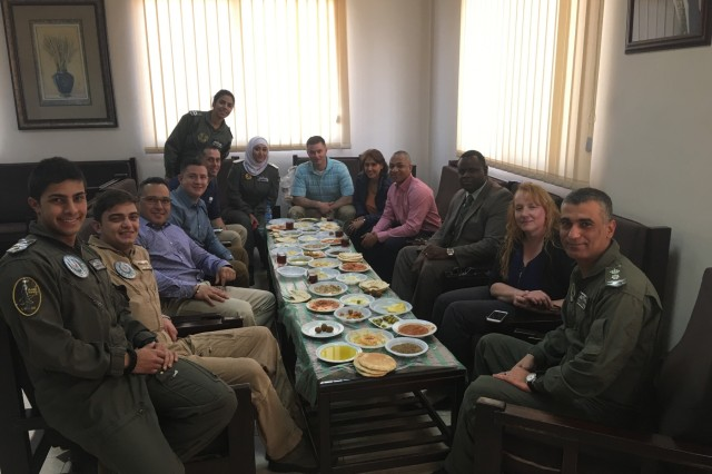 Members of the 248th Aviation Support Battalion and the 1st Battalion, 244th Aviation Regiment (Assault), Task Force Spartan enjoy a traditional Jordanian breakfast with the 8th Squadron commander and his team located at King Abdullah I Air Base, Marka. The 8th Squadron mission is to support three battalions of a newly-developed quick reaction force unit that covers the entire country of Jordan.